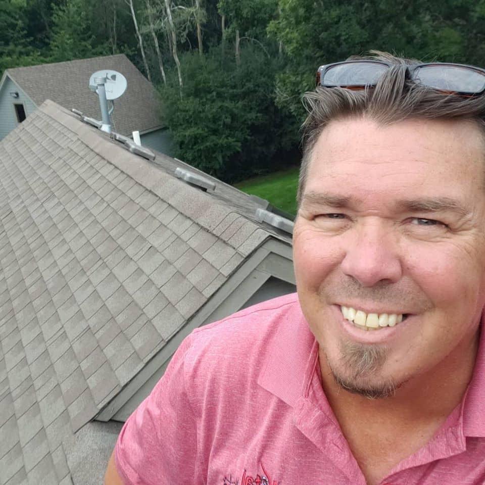 Home Inspector Lee Verhagen on roof